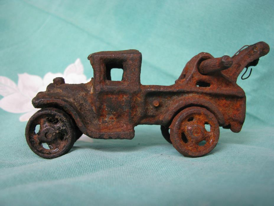 Antique cast iron toy tow truck