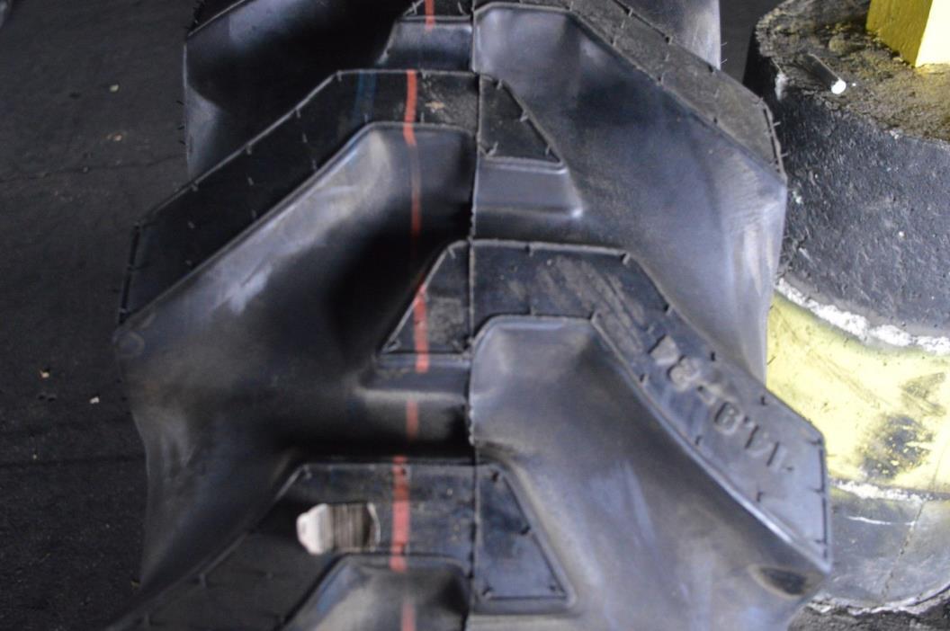 14.9-24 NEW MAJOR BRAND OVERSTOCKS R-4 12 PLY TUBELESS TIRE