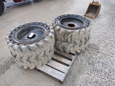 Solid Rubber Industrial Tires Off Of John Deere 326D Skid Steer Loader, 8 Lug