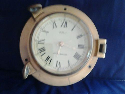 Vintage Royal Mariner brass wall clock. Battery operated.