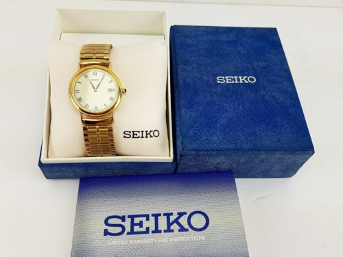 Seiko SKP016 Men's Dress Gold Tone Dial Stainless steel stretch band Watch