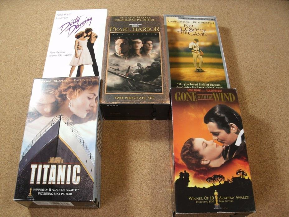 LOT OF 8 VHS TITANIC (1 & 2), GONE WITH THE WIND (2), PEARL HARBOR (2), DIRTY DA