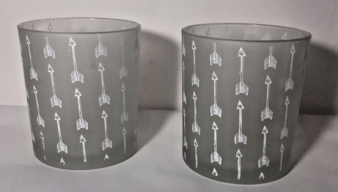 Set of Two Glass Candle Holders With Arrow Design