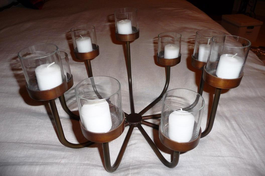 Candlelabra, round copper colored with 9 glass votive holders, varying heights