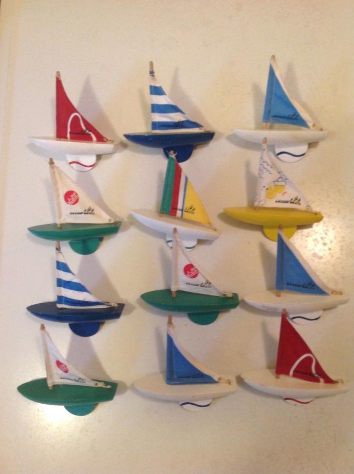 12 Vintage Wooden Bosun Sailboats.