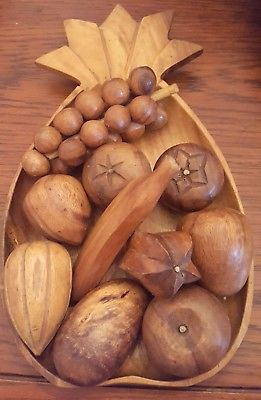 Wooden pineapple bowl with fruit