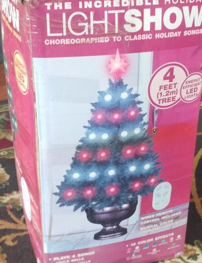 Gemmy The Incredible Lightshow 4' Tree Brand new - Musical Tree color changing