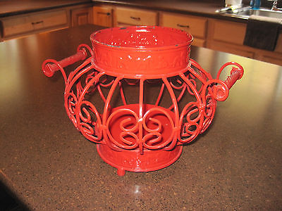 Large red metal candle holder