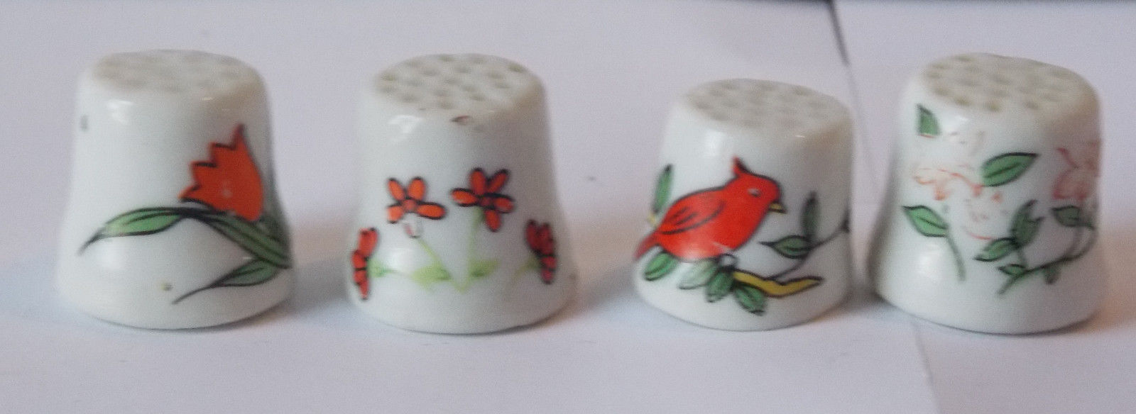 4 thimbles Floral theme - Tulips, Pink, Red and a Cardinal - Unmarked
