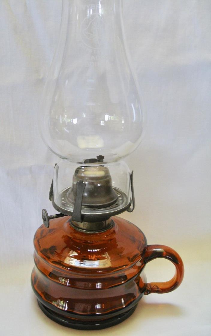 A BEAUTIFUL ANTIQUE, AMBER COLOURED, FINGER OIL LAMP - CIRCA 1895