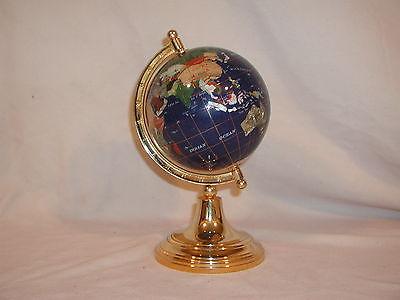 Globe hand made of precious stones