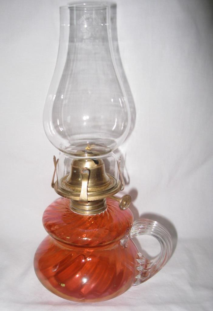 A BEAUTIFUL VICTORIAN PINK/TANGERINE COLOURED FINGER OIL LAMP - CIRCA 1895