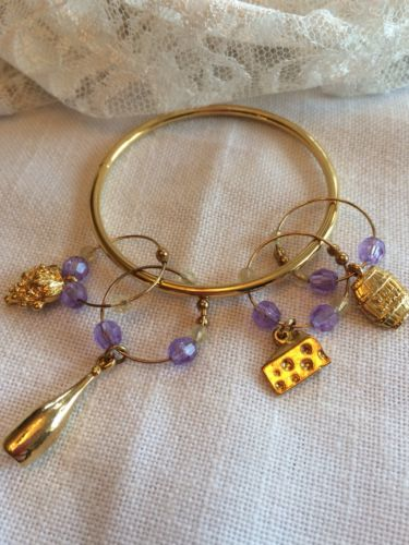 NWOT Gorgeous gold toned purple beads wine charms on a ring set of 4