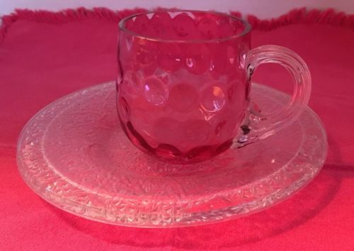 Unusual pink Cup And Saucer. Cranberry Glass?