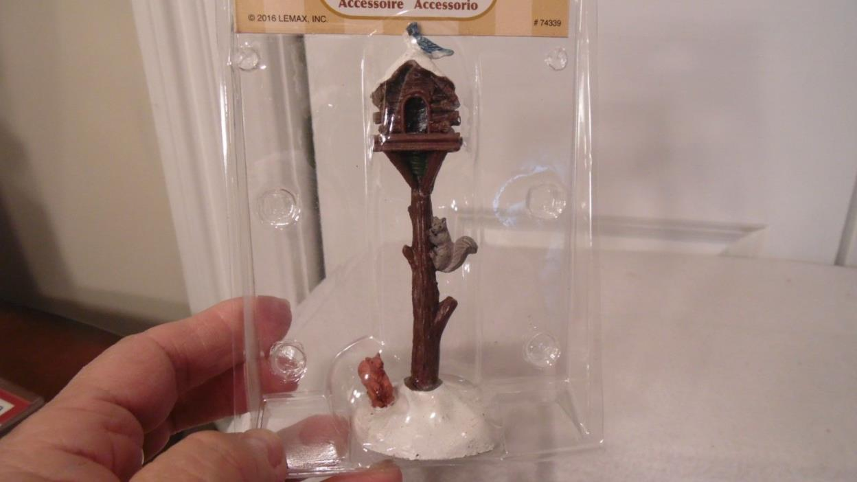 CHRISTMAS VILLAGE ACCESSORY, BIRD HOUSE ON TREE STAND, A SQUIRREL ON STAND