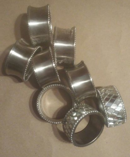 EIGHT SILVER COLLORED  NAPKIN RINGS TWO MIRRORED FOR HEADS OF TABLE