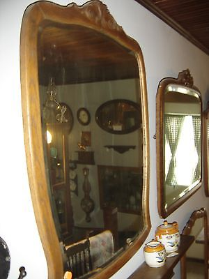 Antique Shaped Oak Beveled Mirror with Applied Carving. 8165