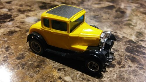 AFX/AURORA FORD MODEL A COUPE SLOT CAR in LEMON YELLOW w/