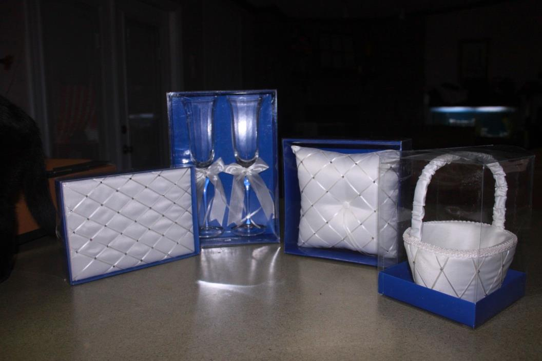 Toasting glasses, flower girl basket, ring pillow and guest book