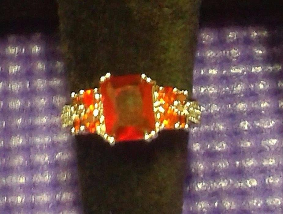 CANADIAN  STERLING SILVER   RING SIZE 9 .RED  GARNET.NEW