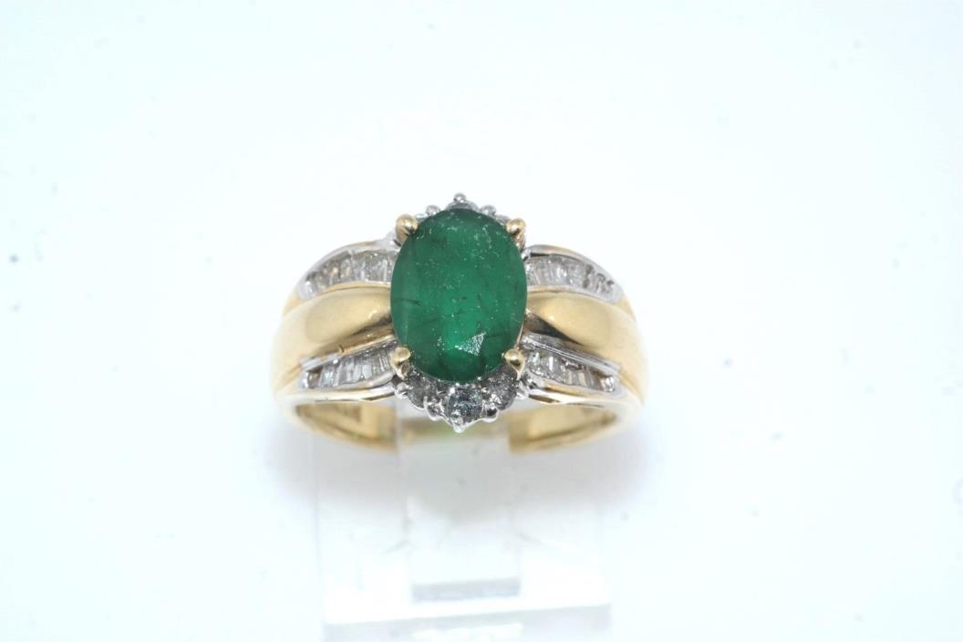 1.25 carat Oval Emerald & Baguette Diamond 14k Yellow Gold Ring