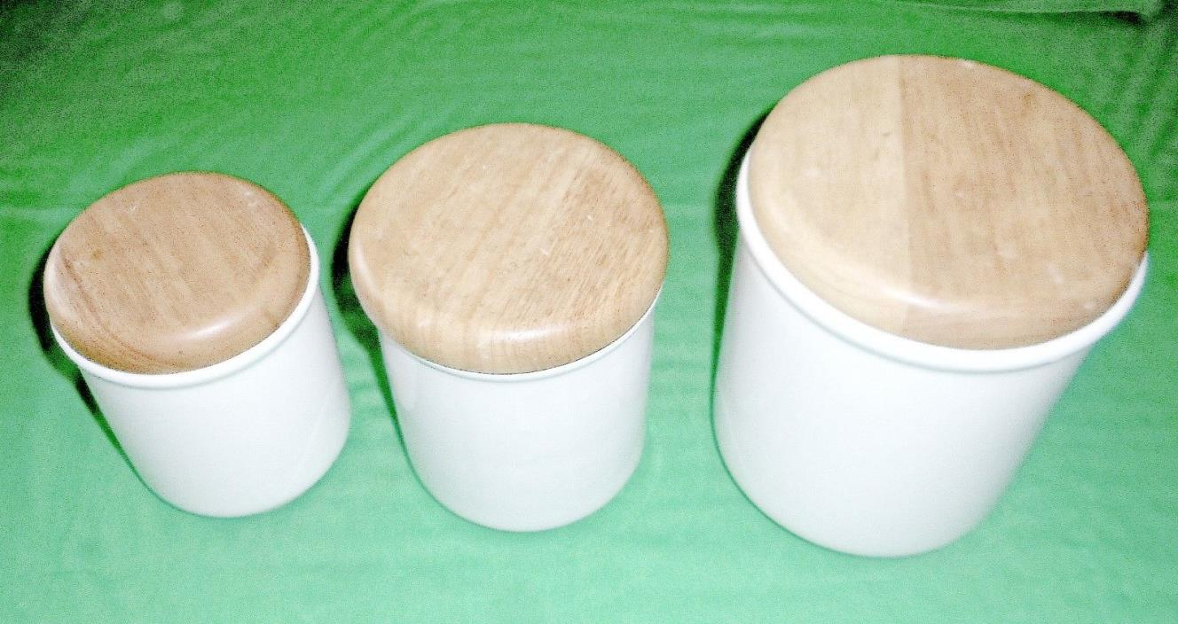 3 PIECE WHITE CANISTER SET WITH WOOD LIDS (745)