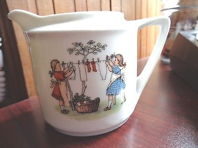VINTAGE CREAMER  CHILDREN HANGING CLOTHES ON LINE  MADE IN GERMANY