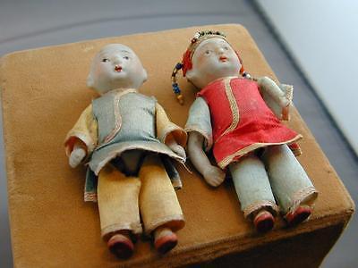 Vintage Pair of Japanese Porcelain Dolls w/Silk or Satin Clothing