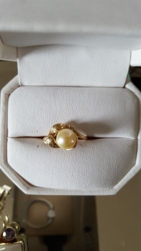 14kt yellow gold Genuine Pearl with diamond ring.