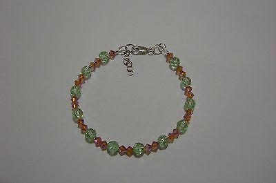 Bracelet made with Chryosolite + Topaz AB2X Swarovski Crystals + Sterling Silver