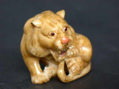 Estate Japanese ivory colored bone netsuke -Baby Tiger cries for its Mommy