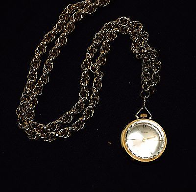Vintage Nelson pocket watch on gold tone chain ; 1 jewel; Swiss movement; works!