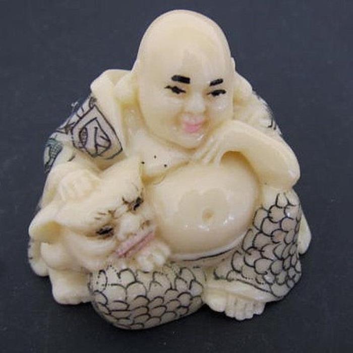 Japanese ivory color bone netsuke - hotei buddha has pet bulldog