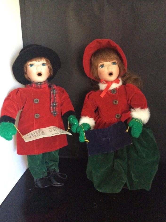 "Boy and girl Caroler porcelain  dolls, 13"" high"
