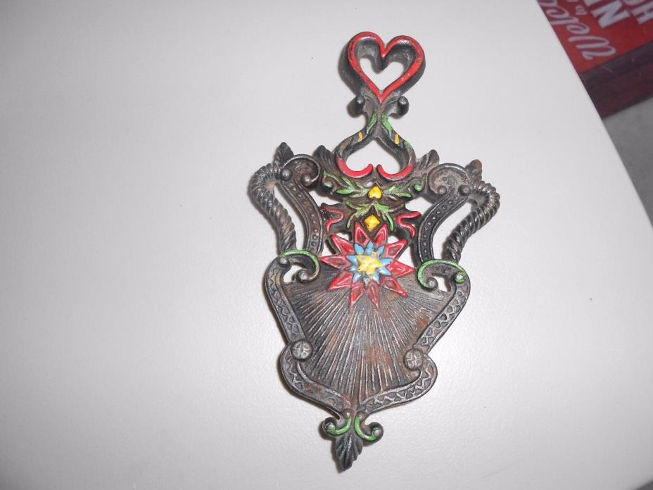 Antique Trivet  heart at top star in middle