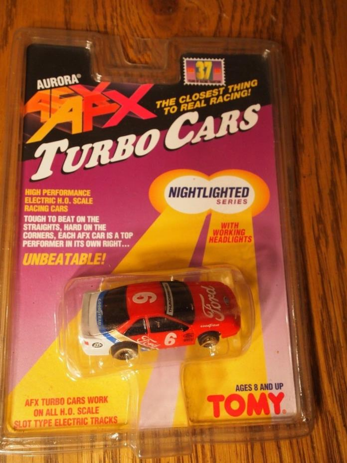 Tomy Aurora AFX Turbo car Ho scale Night-lighted Ford race car,  on sealed card