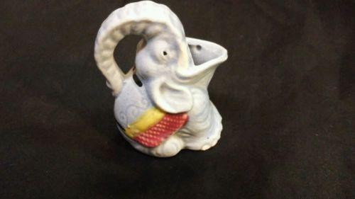 Antique porcelain or ceramic cream pitcher
