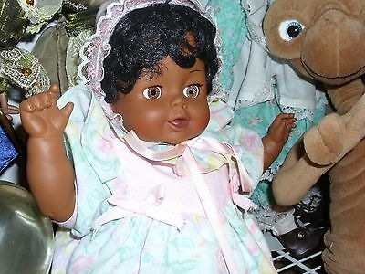 RUBBER AA DOLL  CUTE WITH CURLY HAIR   BONNET MATCHING DRESS, SHOES, UNDER WEAR
