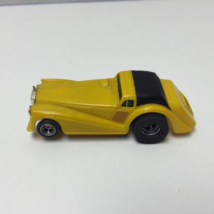 A/FX YELLOW  ROARIN ROLLS ROYCE aurora afx magnatraction ho slot car