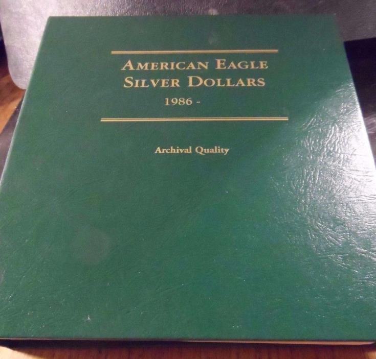 PREOWNED AMERICAN EAGLE SILVER DOLLAR 1986----> COIN COLLECTOR BOOK(110717)