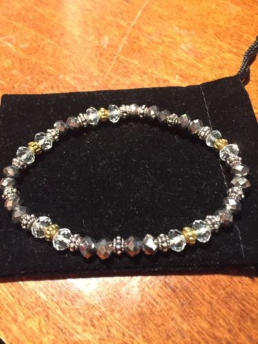 Silver & Clear Faceted 6mm Crystals, Bali Silver & Gold Beads. Stretch Bracelet