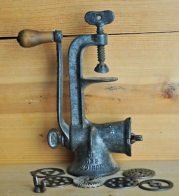 Vintage Meat Grinder Food Chopper Cast Iron with 7 cutters Patented 1908