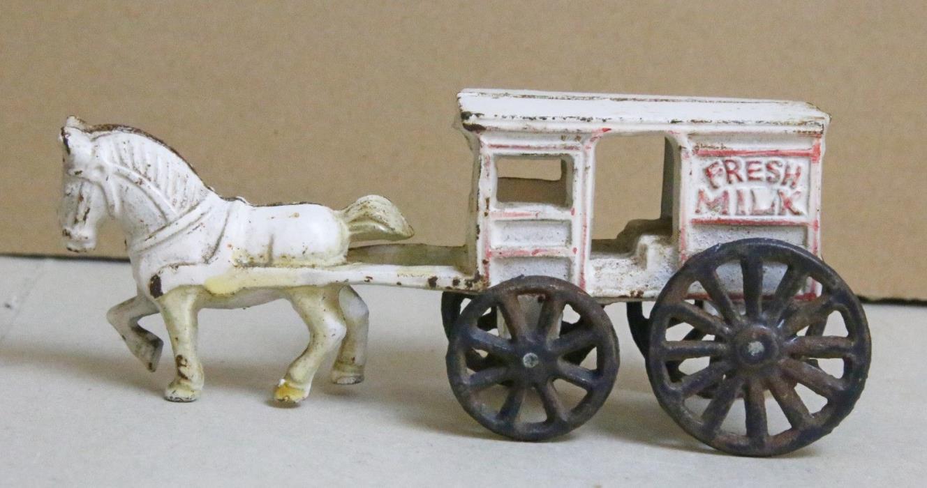 Vintage cast iron toy milk wagon, white, black, red