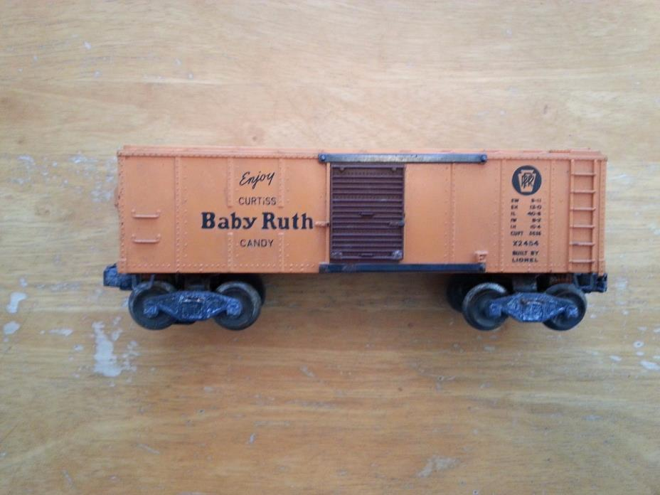 One Vintage Lionel O scale # X 2454 Baby Ruth boxcar.dusty,rusty and crusty.