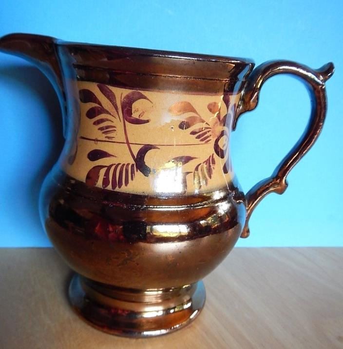 Copper luster pitcher; 5