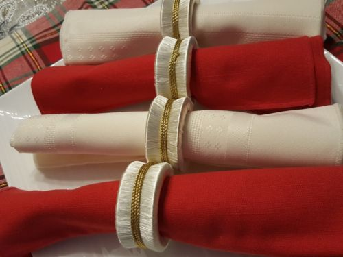 4 Unused White with Gold trim Napkin Rings
