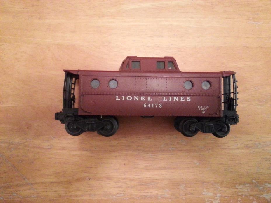 One Vintage Lionel O scale # 64173 Lionel lines illuminated porthole caboose.