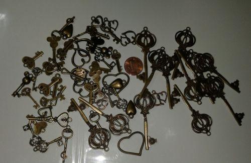 Lot of 50 Brass Key Pendants Never Used Fancy 1/2-2