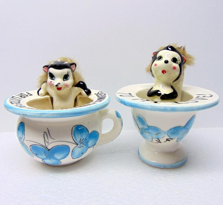Pair of Skunk Figurines in Cups, Ceramic, Each about 4 1/2 to 5