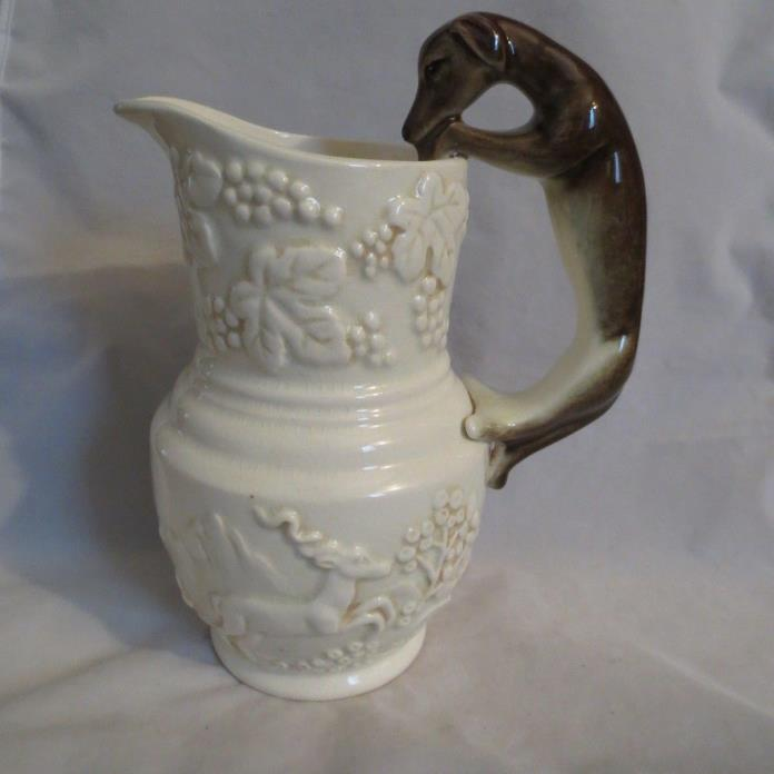 ANTIQUE RELIEF POTTERY PITCHER with DOG HANDLE  (8